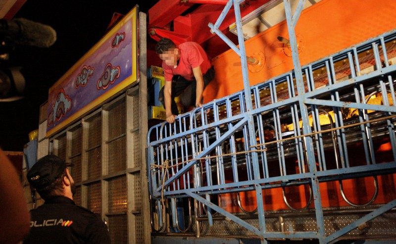 Police search for stowaways as the roller coasters are dismantled after the Feria de Melilla