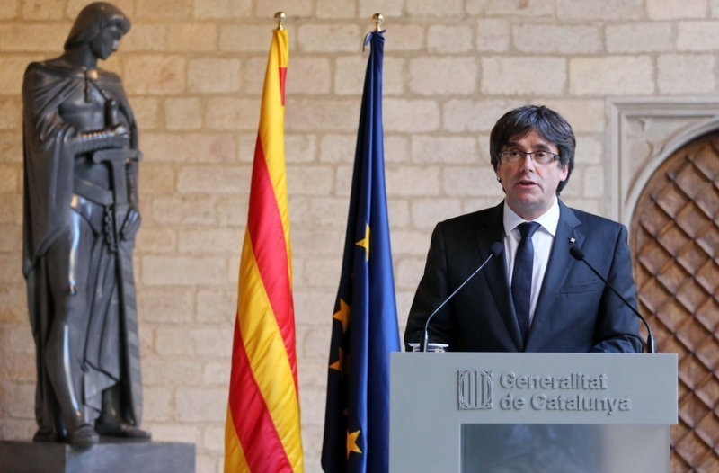 Former Catalan president still hopes to be re-invested in his absence