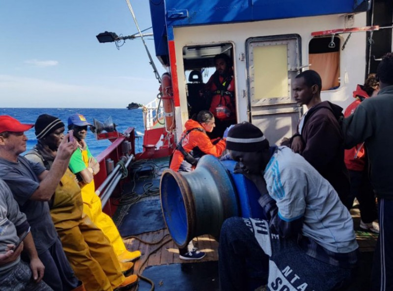 Medical help for migrants stranded on Spanish fishing boat off the coast of Libya
