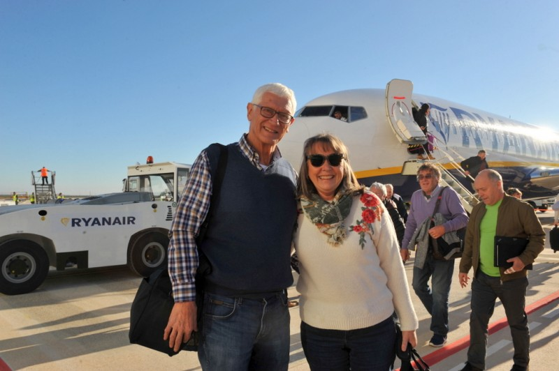 Annie and Peter make history as the first passengers into Corvera airport