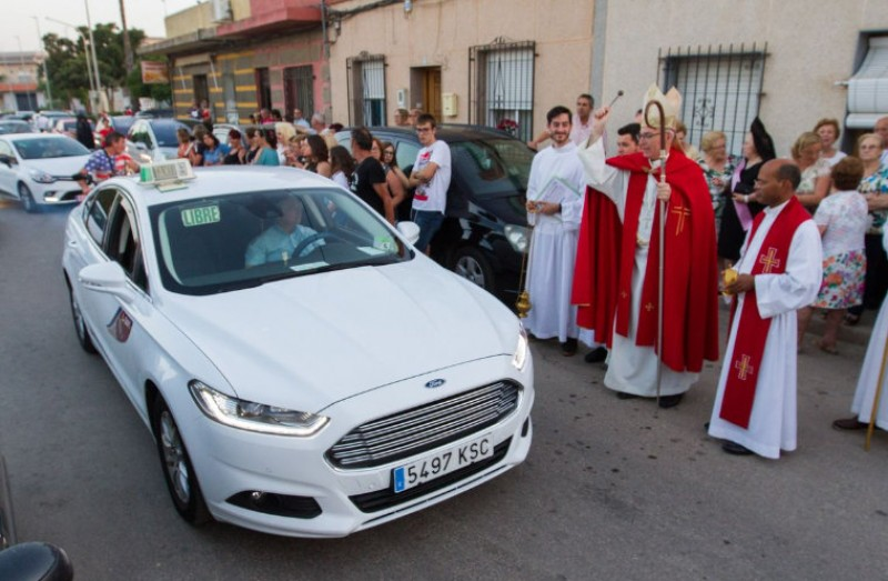 Taxis receive blessing from the priest on the day of San Cristóbal in Cartagena