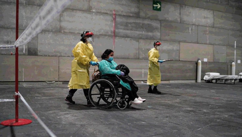 <span style='color:#780948'>ARCHIVED</span> - Exhibition centre in Madrid receives first patients as emergency coronavirus hospital