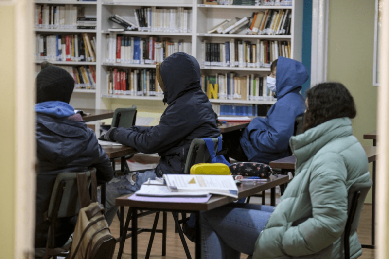 Pupils and teachers shiver in freezing classrooms across Spain to comply with covid measures