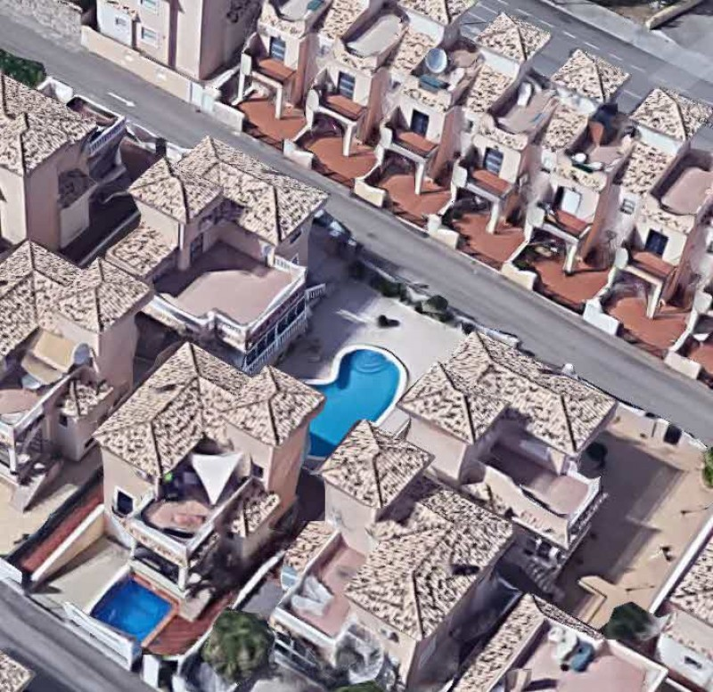 What are the consequences of having building work for extensions or pools carried out without a building licence in Spain?